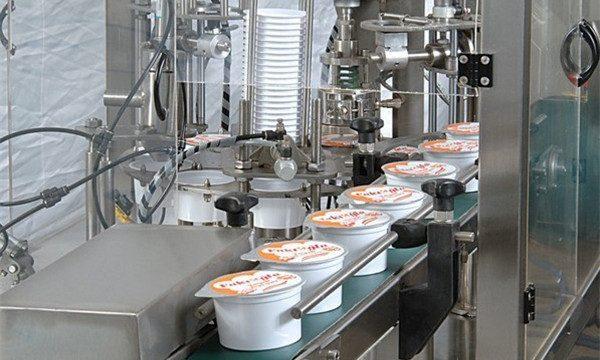 Automaatne jäätisetopsitäidise tihendusmasin