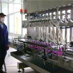 Automaatne pöörlevate pudelite täitmise masin korgiga